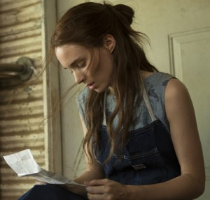 Rooney Mara as Ruth reading a letter from her imprisoned husband.