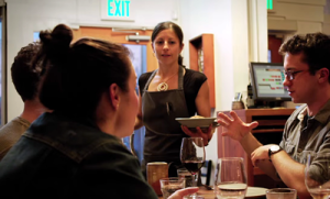 Cortney Burnes serving customers at Bar Tartine